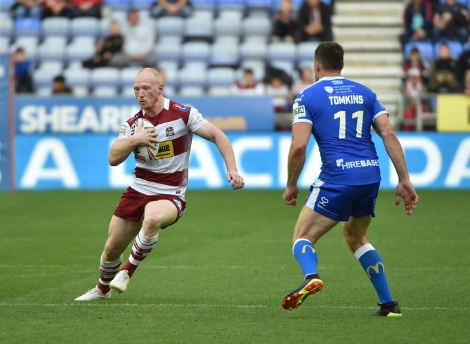Match action from Wigan Warriors vs Hull KR at the DW Stadium.