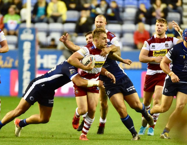 Match action from Wigan Warriors vs Catalans Dragons.