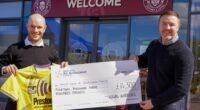 Warriors present £14,300 to NWAA